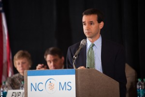 State epidemiologist Zack Moore, MD, MPH, speaks before the NCMS House of Delegates on Friday, October 24.